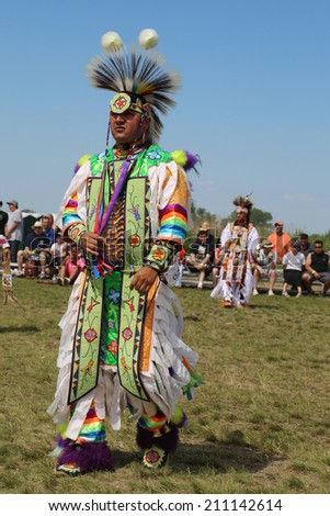 NEW YORK - JUNE 8: Unidentified Native American at the NYC Pow Wow in Brooklyn on June 8, 2014. A pow-wow is a gathering and Heritage Celebration of North America s Native people