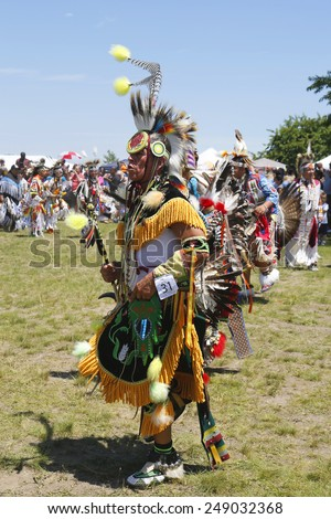 NEW YORK - JUNE 8, 2014: Unidentified Native American dancer at the NYC Pow Wow in Brooklyn. A pow-wow is a gathering and Heritage Celebration of North America s Native people