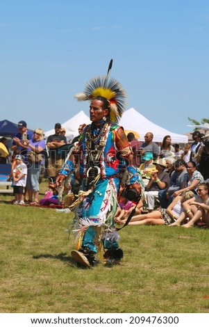 NEW YORK - JUNE 8: Unidentified Native American dancer at the NYC Pow Wow in Brooklyn on June 8, 2014. A pow-wow is a gathering and Heritage Celebration of North America s Native people