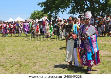 NEW YORK - JUNE 8: Unidentified Native American female dancers during NYC Pow Wow parade in Brooklyn on June 8, 2014. A pow-wow is a gathering and Heritage Celebration of North America s Native people - stock photo