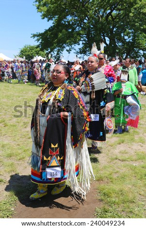 NEW YORK - JUNE 8: Unidentified Native American female dancers during NYC Pow Wow parade in Brooklyn on June 8, 2014. A pow-wow is a gathering and Heritage Celebration of North Americas Native people - stock photo