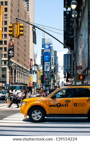 NEW YORK - JUNE 28: Yellow cab in Times Square. T. S. is a busy tourist intersection of commerce Advertisements and a famous street of New York City and US, seen on June 28, 2012 in New York, NY. - stock photo