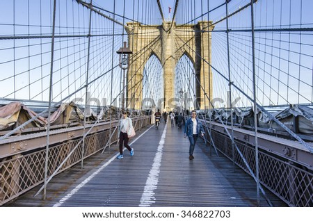 New York, Manhattan,  USA - May 7, 2013: Unidentified people running on famous Brooklyn Bridge in Manhattan.