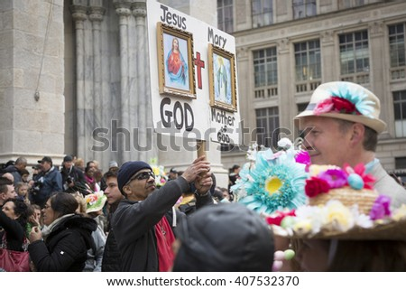 NEW YORK - MAR 27 2016: A man holding a religious sign stands on 5th Avenue in front of St Patricks Cathedral Easter Sunday during the traditional Easter Bonnet Parade in Manhattan on March 27, 2016. - stock photo
