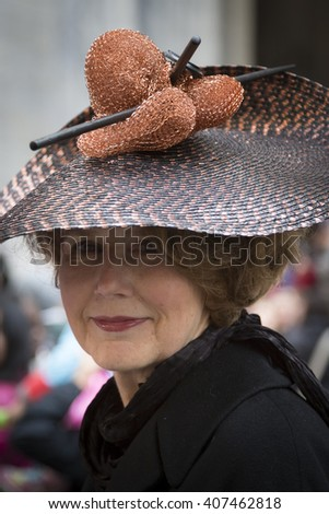 NEW YORK - MAR 27 2016: A woman wearing an Easter bonnet with copper dish pads held with hair sticks on 5th Ave Easter Sunday at the traditional Easter Bonnet Parade in Manhattan on March 27, 2016.