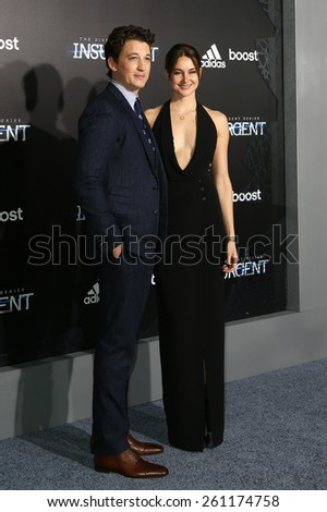 "NEW YORK-MAR 16: Actors Miles Teller (L) and Shailene Woodley attend the U.S. premiere of ""The Divergent Series: Insurgent"" at the Ziegfeld Theatre on March 16, 2015 in New York City. - stock photo"