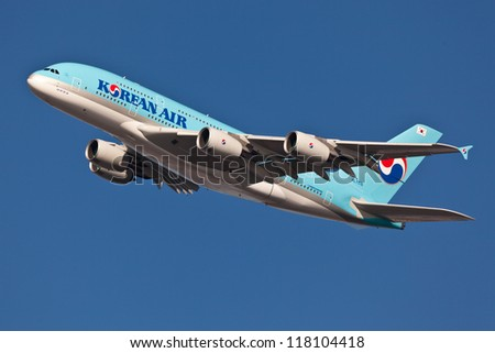 NEW YORK - MARCH 20:A380 Korean Air climbs after takeoff for JFK in New York, USA on March 20, 2012 Blue top livery was introduced on in 1984 A380 is the biggest passenger plane in the world - stock photo