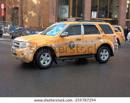 NEW YORK - MARCH 6: A salt covered yellow Manhattan taxi cab on March 6, 2015 in New York. Yellow (medallion taxis) are able to pick up passengers anywhere in the five boroughs.  - stock photo