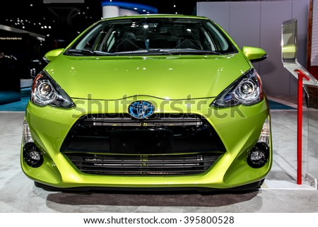 NEW YORK - March 23: A Toyota Prius c exhibit at the 2016 New York International Auto Show during Press day,  public show is running from March 25th through April 3, 2016 in New York, NY. - stock photo