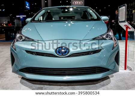 NEW YORK - March 23: A Toyota Prius exhibit at the 2016 New York International Auto Show during Press day,  public show is running from March 25th through April 3, 2016 in New York, NY. - stock photo