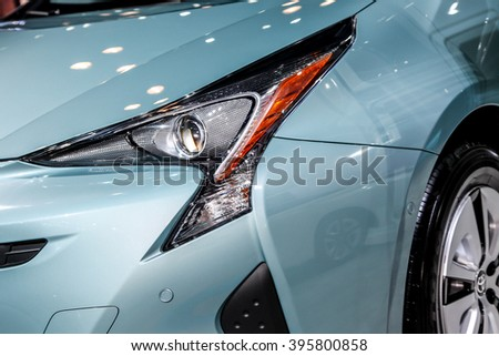 NEW YORK - March 23: A Toyota Prius front headlight exhibit at the 2016 New York International Auto Show during Press day, public show is running from March 25th through April 3, 2016 in New York, NY. - stock photo