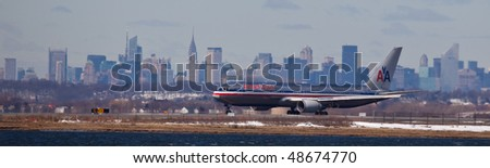 NEW YORK -MARCH 1:Boeing 767 American Airlines departing from JFK Airport on Runaway 4L with Manhattan skyline in background on March 1, 2010 in New York. Picture taken from Bayswater Park
