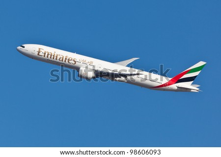 NEW YORK - MARCH 10: Boeing 777 Emirates climbs after take off from JFK airport located in New York March 10, 2012 Emirates is rated as a top10 best airline in the world flying on youngest fleet