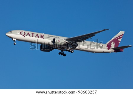 NEW YORK - MARCH 5:Boeing 777 Qatar on final approach to JFK in New York, USA on March 5, 2012 Qatar Airline is rated 3rd best airlines in the world Qatar airline is flag carrier airline of Qatar