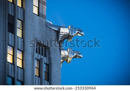 NEW YORK - MARCH 6, 2014: Chrysler building gargoyles on March 6 2011 in New York.  Chrysler building was the world's tallest building before it was surpassed by the Empire State Building in 1931.  - stock photo