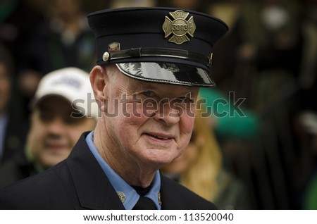 NEW YORK - MARCH 15: Famed Firefighter Bob Beckwith marching alongside fellow FDNY members at the 251st Annual Saint Patricks Day Parade on March 15, 2012. - stock photo