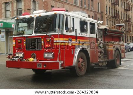 NEW YORK - MARCH 26, 2015: FDNY Engine 53 in East Harlem, Upper Manhattan. FDNY is the largest combined Fire and EMS provider in the world  - stock photo