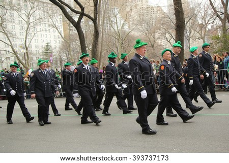NEW YORK - MARCH 17, 2016: Fire Department of New York firefighters marching at the St. Patrick's Day Parade in New York.