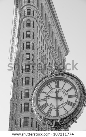 NEW YORK - MARCH 7: Flat Iron building facade on March 7, 2011. Completed in 1902, it is considered to be one of the first skyscrapers ever built, March 7th, 2011 in New York, USA. - stock photo