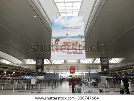 NEW YORK- MARCH 31, 2015: Inside of Delta Airline Terminal 4 at JFK International Airport in New York. JFK is one of the biggest airports in the world with 4 runways and 8 terminals  - stock photo