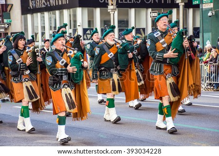 NEW YORK-MARCH 17- Marchers with bagpipes dressed in kilts march in the St Patrickâ??s Day Parade on on 5th Ave in New York City. - stock photo