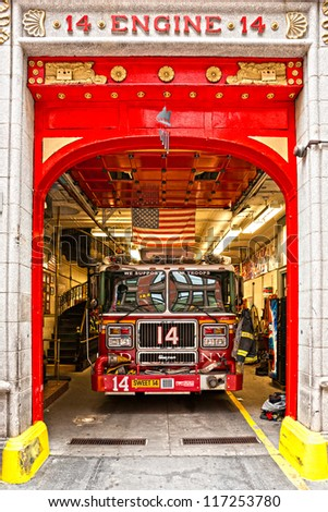 NEW YORK -MARCH 29: New York Fire Department Engine 14. The FDNY is the largest combined Fire and EMS provider in the world.March 29th 2012 in Manhattan, New York City. - stock photo