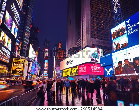 NEW YORK, MARCH 14, 2015: Times Square at night - HDR featuring busy Broadway with animated signs for the Lion King and other shows.  Theater District is a symbol of New York and the United States. - stock photo