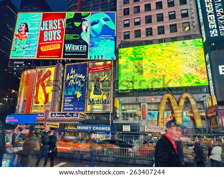 NEW YORK, MARCH 14, 2015: Times Square at night - HDR featuring the flagship McDonald's restaurant and lighted signs for Kinky Boots, Matilda, Le Miserable, and other famous shows. - stock photo