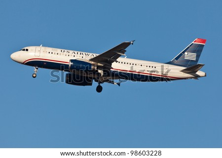 NEW YORK - MARCH 21: US Airways A320 on short final to JFK airport located in New York on Marchy 21, 2012. US Airways operates 3,310 flights a day to 200 destinations in 30 countries - stock photo