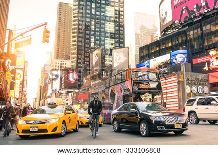 NEW YORK - MARCH 25, 2015: yellow taxi cab and rush hour congestion at Times Square in Manhattan downtown before sunset - Intersection of 7th Avenue with 43rd Street - Warm filtered editing - stock photo