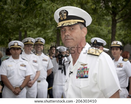 NEW YORK - MAY 23, 2014: A portrait of Rear Admiral Scott A. Stearney standing in front of US Navy officers during the re-enlistment and promotion ceremony at the National September 11 Memorial site. - stock photo