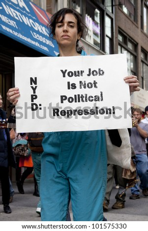 NEW YORK - MAY 1: A protester holds a sign that reads 'NYPD Your Job Is Not Political Repression' during the march to Union Square at Occupy Wall St 'May Day' protests on May 1, 2012 in New York, NY.