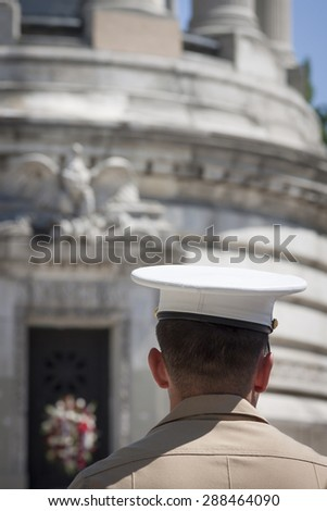 NEW YORK - MAY 25 2015: A US Marine in uniform attends the annual Memorial Day Observance service held at the Soldiers and Sailors Monument in Manhattan during Fleet Week NY 2015. - stock photo