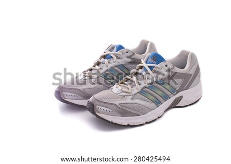 NEW YORK - May 22, 2015: Adidas running shoes - sneakers - trainers, in gray and blue, showing the Adidas logo and famous three stripes - illustrative editorial