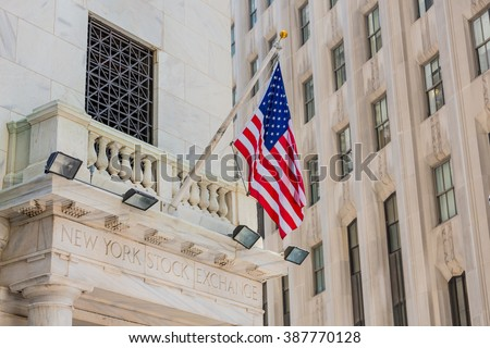 NEW YORK - MAY 04: American flag on the New York Stock Exchange building in Manhattan, New York on May 4, 2015. The NYSE is one of the oldest exchanges in the United States. - stock photo