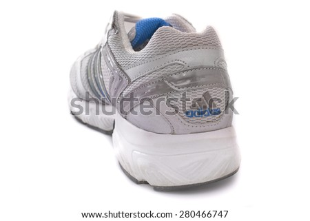NEW YORK - May 22, 2015: An Adidas running shoe - sneaker - trainer, in gray and blue, showing the Adidas logo and famous three stripes - illustrative editorial