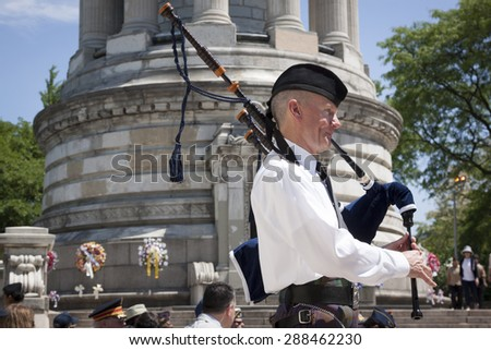 NEW YORK - MAY 25 2015: Bagpiper from New York Scottish Pipes and Drums plays at the Memorial Day Observance service held at the Soldiers and Sailors Monument in Manhattan during Fleet Week NY 2015. - stock photo