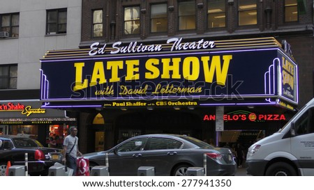 NEW YORK - MAY 12: CBS Late Night Show with david Letterman greets pedestrians on 53rd St in New York City on May 12, 2015. Letterman's last year on the show will be 2015 - stock photo