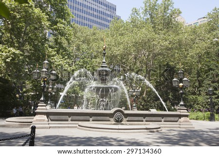 NEW YORK - May 30, 2015: City Hall Park in Manhattan. Surrounded by centuries-old majestic government buildings that date back to 1812, this park provides a much-needed green spot in a downtown area.