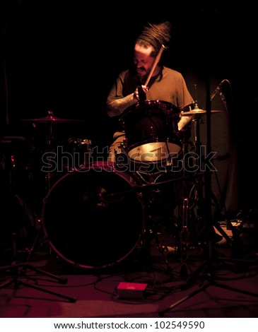 NEW YORK - MAY 09: Craig Santiago drums of Jamie Saft's New Zion trio performs as part of NYC Undead Jazz Festival at Le Poisson Rouge on May 09, 2012 in New York City - stock photo