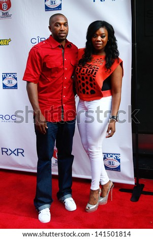 "NEW YORK-MAY 30: Former NBA player Craig ""Speedy"" Claxton and wife Meeka attend the 5th annual Tuck's Celebrity Billiards Tournament at Slate NYC on May 30, 2013 in New York City.  - stock photo"