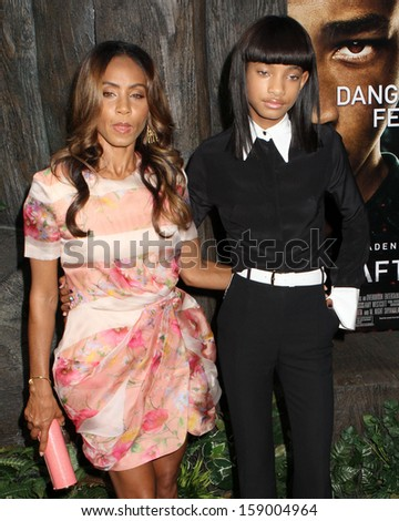 """NEW YORK - MAY 29: Jada Pinkett Smith and WIllow Smith attend the premiere of """"After Earth"""" at the Ziegfeld Theatre on May 29, 2013 in New York City.  - stock photo"""