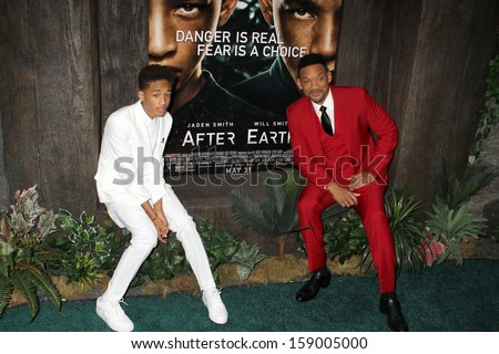 """NEW YORK - MAY 29: Jaden Smith and WIll Smith attend the premiere of """"After Earth"""" at the Ziegfeld Theatre on May 29, 2013 in New York City.  - stock photo"""