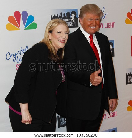 """NEW YORK-MAY 20: Lisa Lampanelli and Donald Trump attend the """"Celebrity Apprentice"""" Live Finale at the American Museum of Natural History on May 20, 2012 in New York City. - stock photo"""