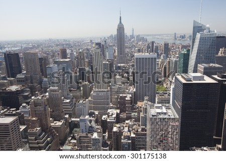 NEW YORK - May 29, 2015: Manhattan Skyline and Empire State Building, viewed from Rockefeller Plaza at night, New York City. - stock photo