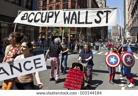 NEW YORK - MAY 19: Members of Occupy Wall Street movement perform on Broadway as part of New York Dance Parade on May 19, 2012 in New York City - stock photo