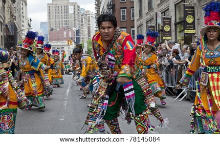 NEW YORK - MAY 21: Members of Pasion Boliviana group dances on Broadway as part of New York Dance Parade on May 21, 2011 in New York City