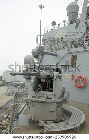 NEW YORK - MAY 22: MK-38 25mm chain gun aboard the guided-missile destroyer USS Cole during Fleet Week 2014 on May 22, 2014 in New York