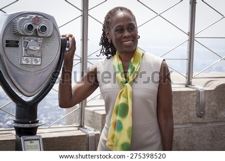 NEW YORK - MAY 5, 2015: New York First Lady Chirlane McCray poses on the observatory deck of the Empire State Building after a ceremony to bring awareness for mental health needs and services in NYC. - stock photo