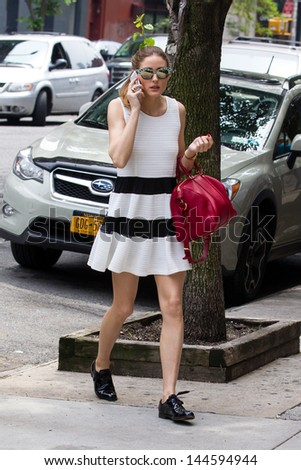 New York, May 29, 2013. Olivia Palermo wears a white dress and carries red bag as she runs errands in NYC. - stock photo